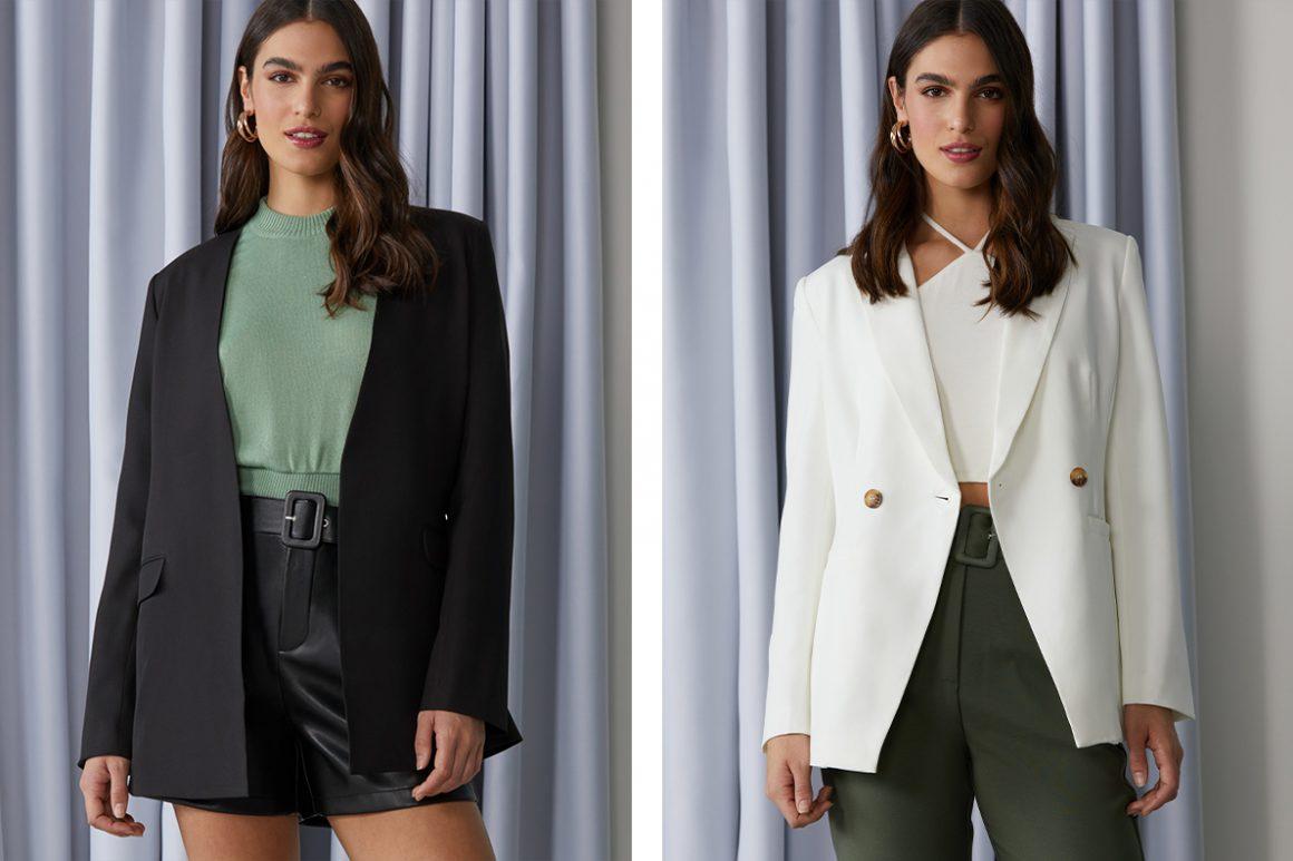Primeira modelo vestindo blazer preto alongado e segunda modelo vestindo blazer branco
