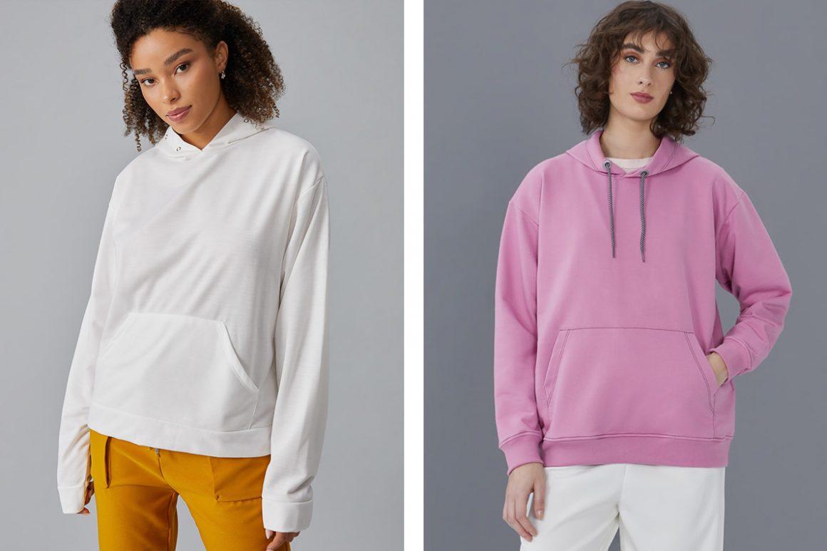 Primeira modelo vestindo moletom branco e segunda modelo vestindo moletom rosa